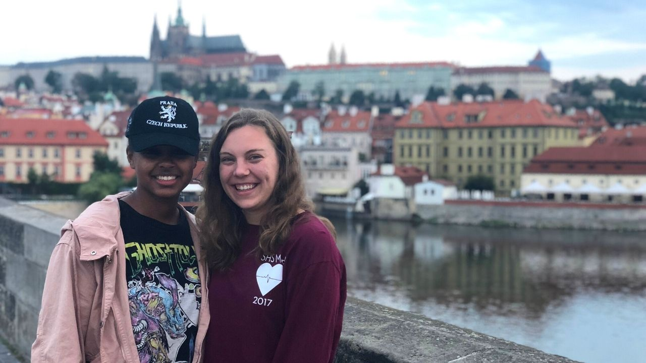 Two students on a study abroad program on the Prague's Charles Bridge