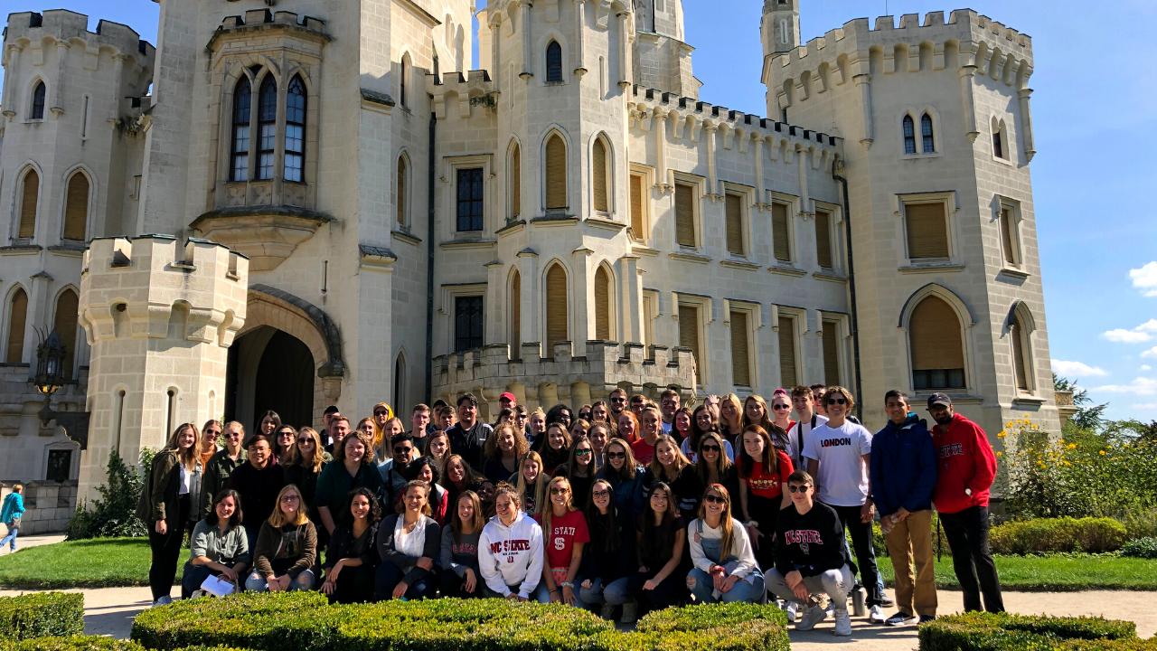 Group of about 60 students in front of Czech castle Hluboka